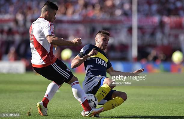 Jorge Moreira of River Plate fights for the ball with Rodrigo Bentancur of Boca Juniors during a match between River Plate and Boca Juniors as part...