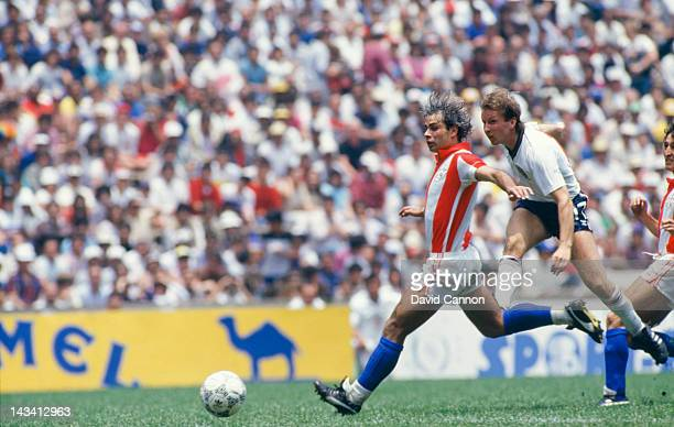 Jorge Nunez of Paraguay and England player Gary Stevens in action during their Round of 16 match at the World Cup competition at the Estadio Azteca...
