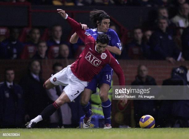 Jorge Nuno Valente Everton and Cristiano Ronaldo Manchester United battle for the ball