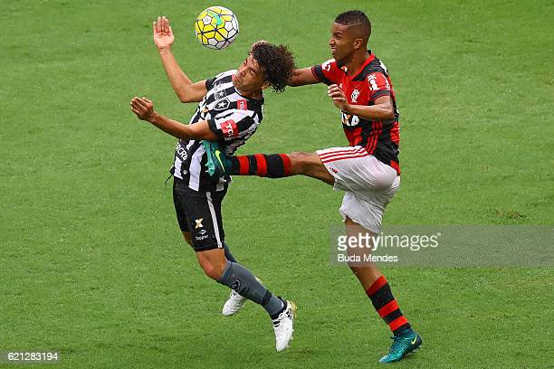 Jorge of Flamengo struggles for the ball with Camilo of Botafogo during a match between Flamengo and Botafogo as part of Brasileirao Series A 2016 at...