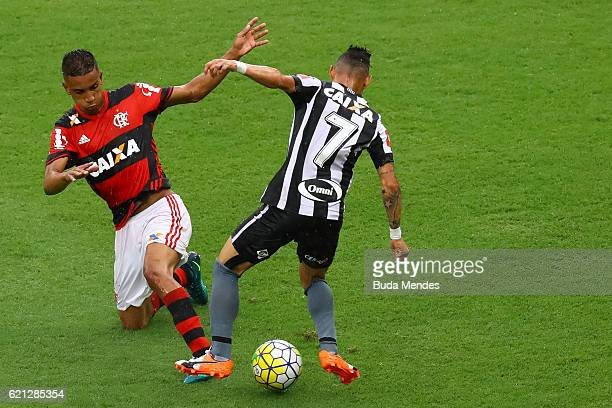 Jorge of Flamengo struggles for the ball with Neilton of Botafogo during a match between Flamengo and Botafogo as part of Brasileirao Series A 2016...