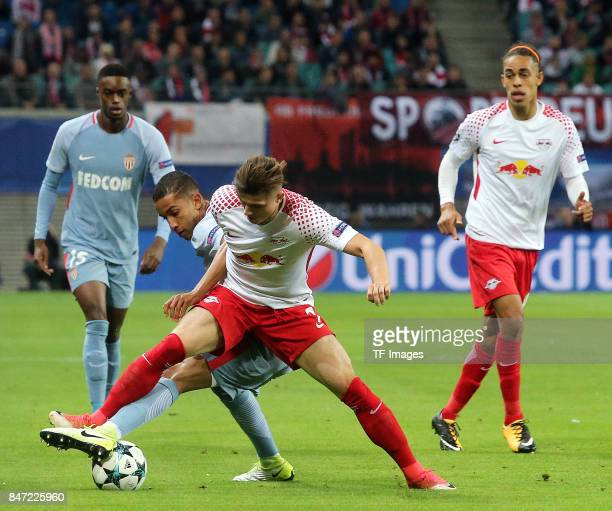 Jorge of Monaco and Marcel Sabitzer of Leipzig battle for the ball during the UEFA Champions League group G match between RB Leipzig and AS Monaco at...