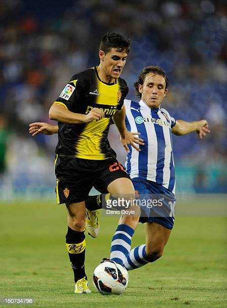 Jorge Orti Real Zaragoza is challenged by Joan Verdu of RCD Espanyol during the La Liga match between RCD Espanyol and Real Zaragoza at Nuevo Estadio...