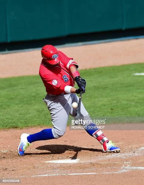 Jorge Padilla of Criollos de Caguas of Puerto Rico bats during a Caribbean Baseball Series match against Aguilas del Zulia of Venezuela at the...