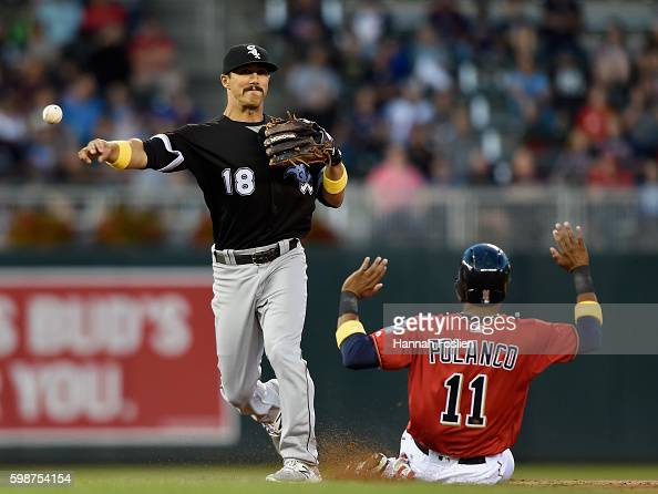 Jorge Polanco of the Minnesota Twins is out at second base as Tyler Saladino of the Chicago White Sox turns a double play during the first inning of...