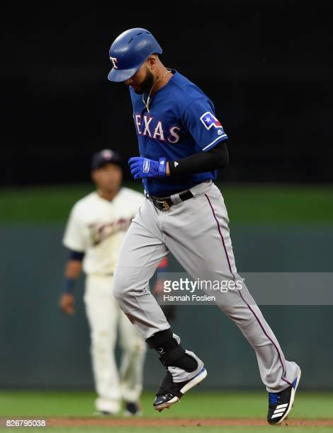 Jorge Polanco of the Minnesota Twins looks on as Nomar Mazara of the Texas Rangers rounds the bases after hitting a tworun home run during the first...