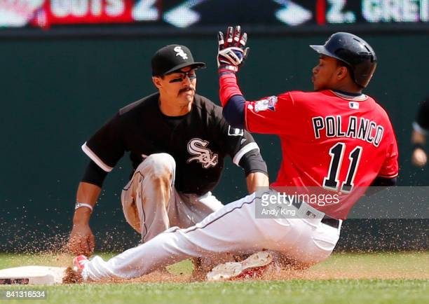 Jorge Polanco of the Minnesota Twins slides safely into second base as the tag by Tyler Saladino of the Chicago White Sox was late in the fifth...