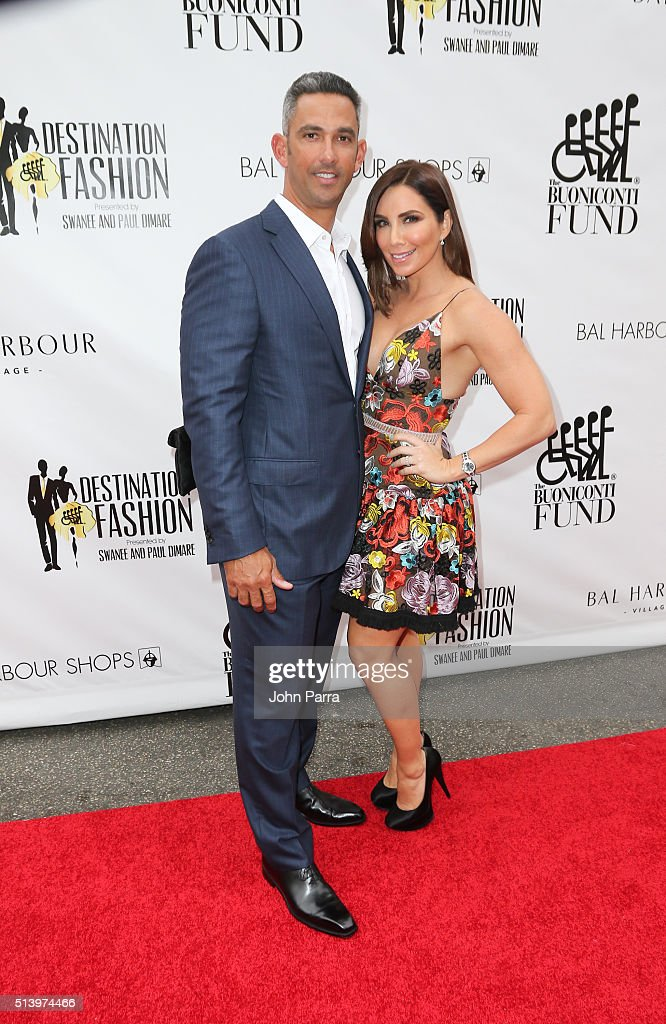 Jorge Posada and Laura Posada attend Destination Fashion 2016 to benefit The Buoniconti Fund to Cure Paralysis, the fundraising arm of The Miami Project to Cure Paralysis at Bal Harbour Shops on March 5, 2016 in Miami, Florida.