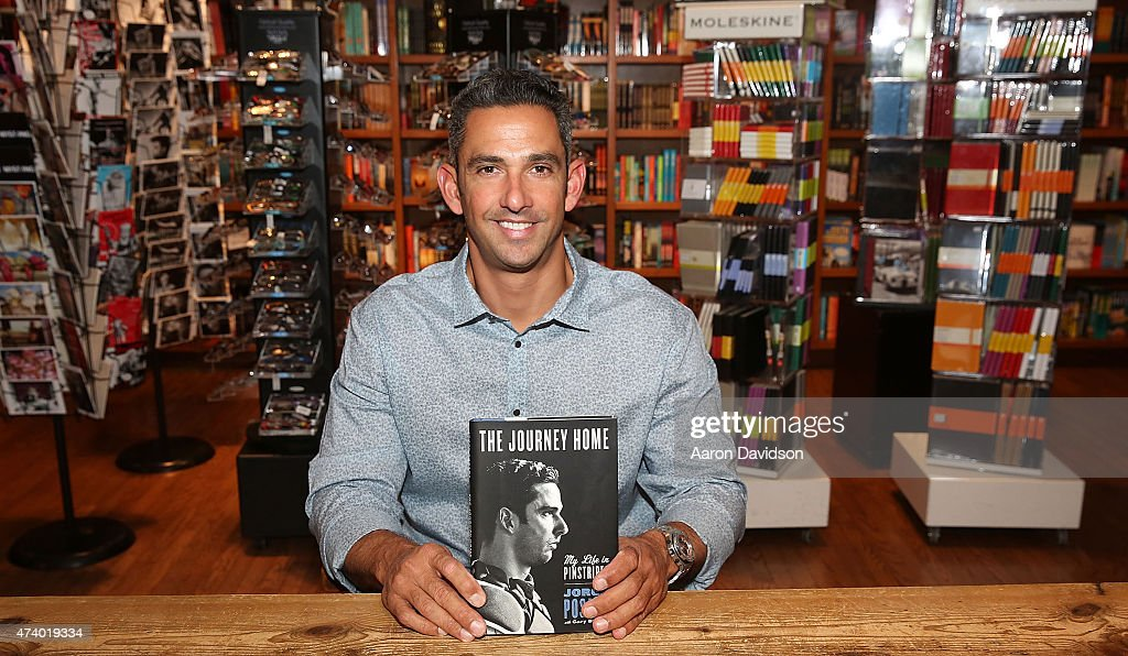 Jorge Posada greets fans and signs copies of his book 'The Journey Home: My Life In Pinstripes' at Books and Books on May 19, 2015 in Coral Gables, Florida.