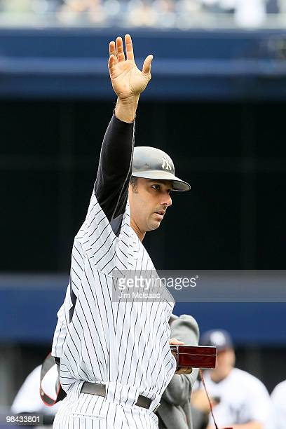 Jorge Posada of the New York Yankees acknowledges the fans after he received his 2009 World Series ring prior to playing against the Los Angeles...