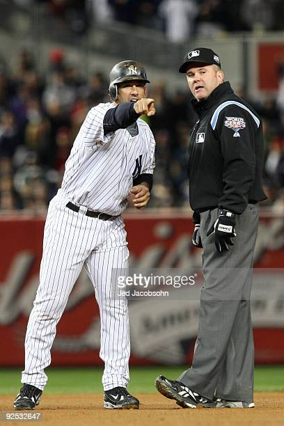 Jorge Posada of the New York Yankees agrues being called out by umpire Mike Everitt in the seventh inning against the Philadelphia Phillies in Game...