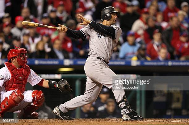 Jorge Posada of the New York Yankees hits a double in the top of the ninth inning against the Philadelphia Phillies in Game Five of the 2009 MLB...