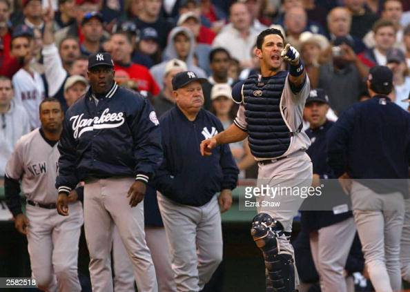 Jorge Posada of the New York Yankees shouts at Pedro Martinez of the Boston Red Sox after he hit a batter during Game 3 of the 2003 American League...