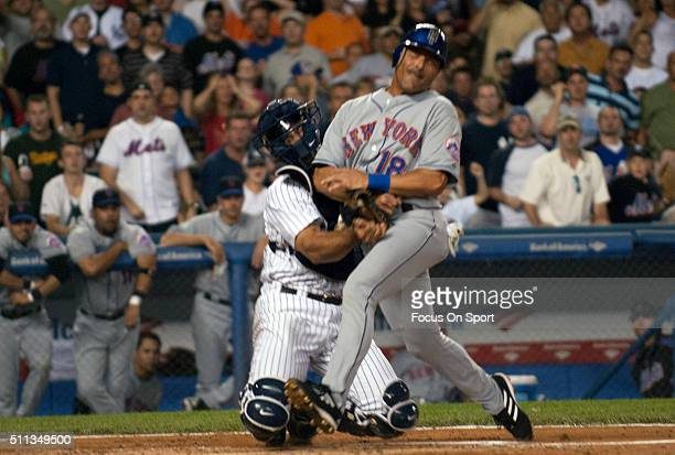 Jorge Posada of the New York Yankees tags out Jose Valentin of the New York Mets during an Major League Baseball game July 2 2006 at Yankee Stadium...