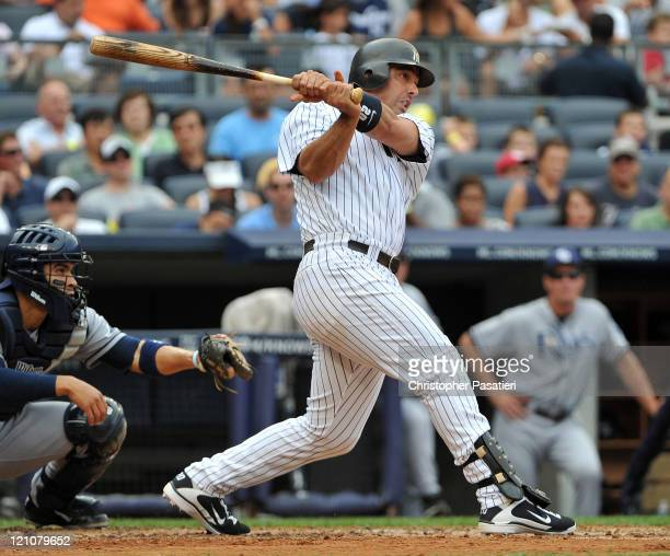 Jorge Posada of the New York Yankees watches his two RBI single in the bottom of the second inning against the Tampa Bay Rays at Yankee Stadium on...