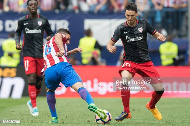 Jorge Resurreccion Merodio Koke of Atletico de Madrid fights for the ball with Aritz Aduriz Zubeldia of Athletic Club during the La Liga match...