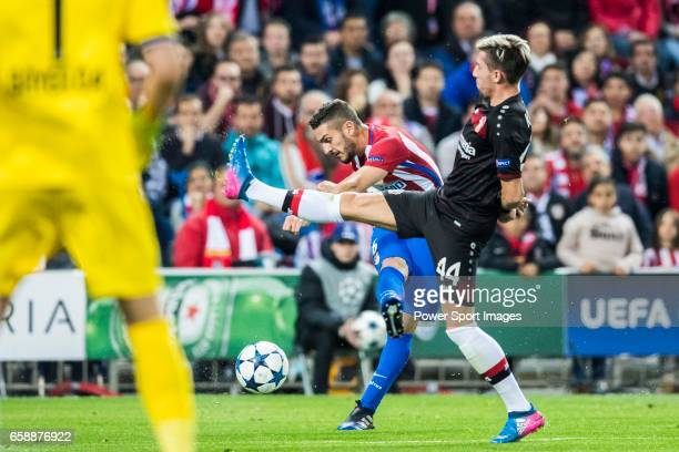 Jorge Resurreccion Merodio Koke of Atletico de Madrid is challenged by Kevin Kampl of Bayer 04 Leverkusen during their 201617 UEFA Champions League...