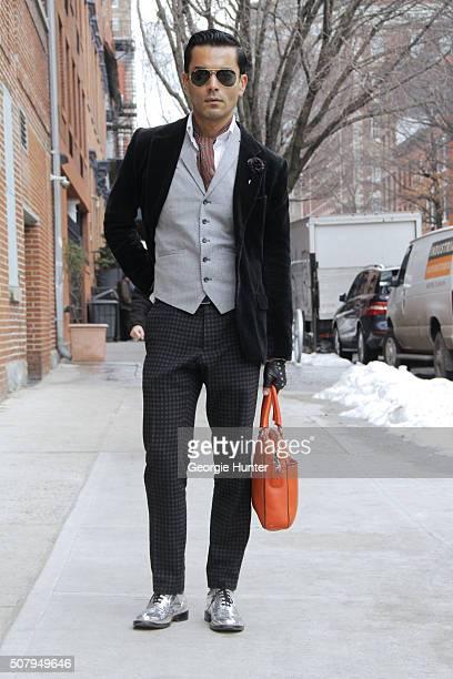Jorge Rios is seen at Industria Superstudios wearing silver Good As Folk brogue shoes grey Gucci suit pants light grey Saint Laurent Paris waistcoat...