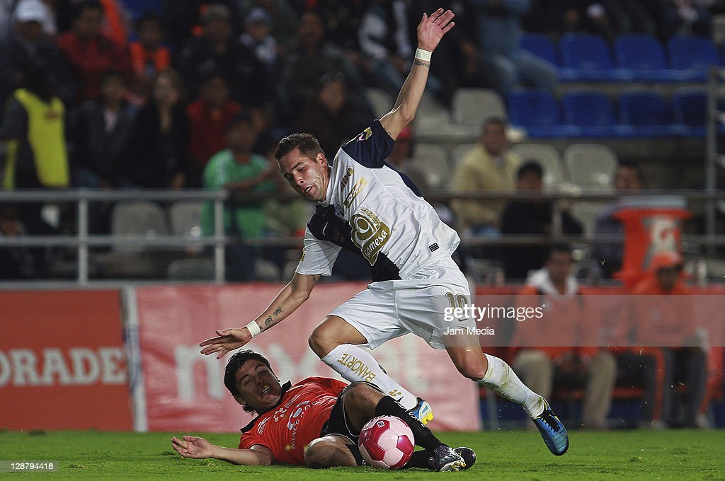 Jorge Rodriguez Jaguares struggles for the ball with Mauro Cejas of Pachuca during a match as part of the Apertura 2011 at Hidalgo Stadium on October...