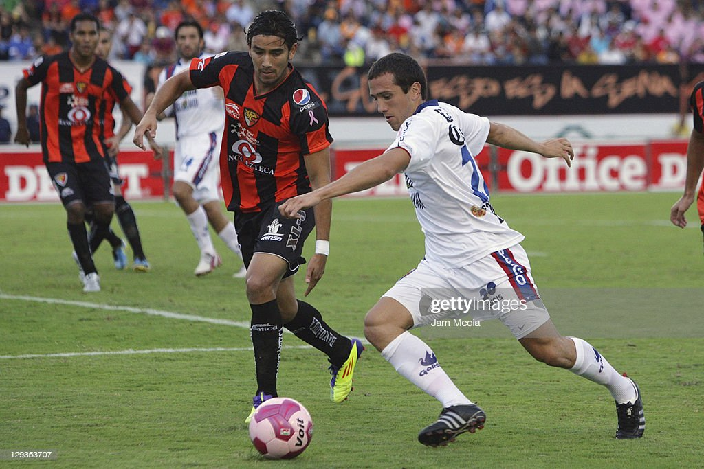 Jorge Rodriguez of Jaguares struggles for the ball with Jeronimo Amione of Atlante during a match as part of the Apertura 2011 at Victor Manuel Reyna...