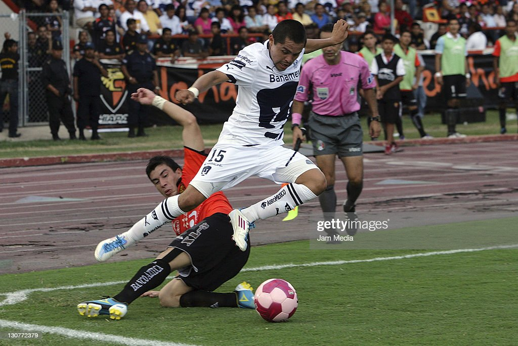 Jorge Rodriguez of Jaguares struggles for the ball with Michelle Castro of Pumas during a match as part of the Apertura 2011 at Victor Manuel Reyna...