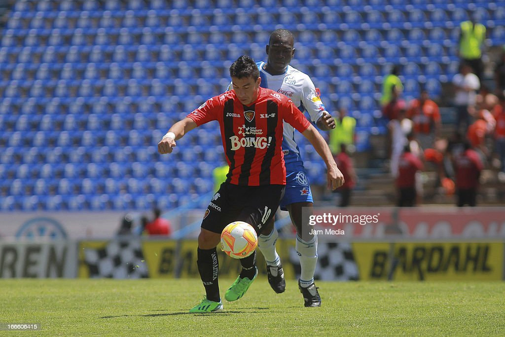 Jorge Rodriguez (R) of Jaguares struggles for the ball with Segundo Castillo (L) of Puebla during a match between Jaguares and Puebla as part of Clausura 2013 Liga MX at Cuauhtemoc Stadium on April 14, 2013 in Puebla, Mexico.