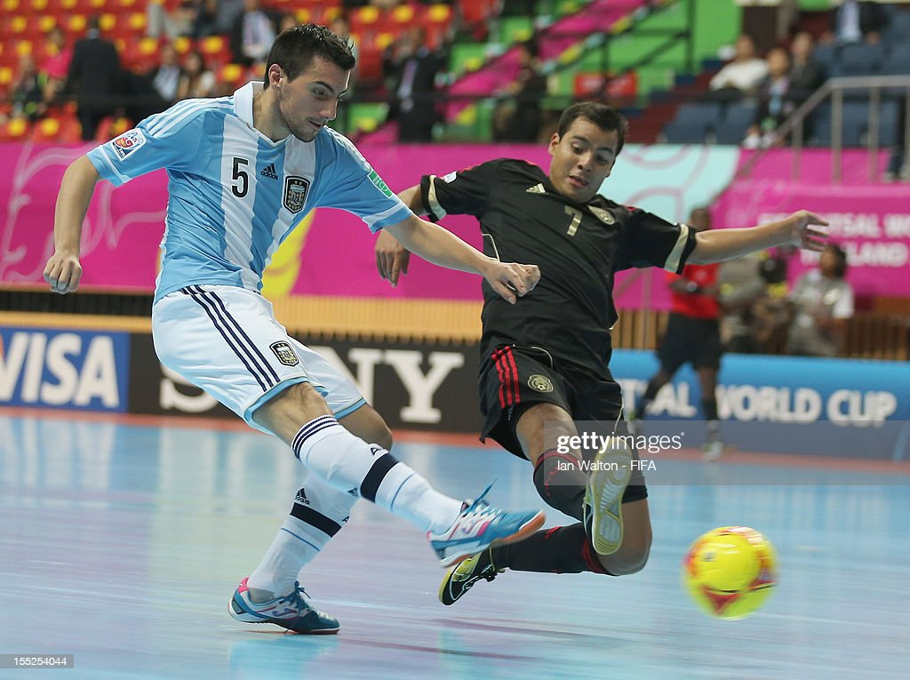 Jorge Rodriguez of Mexico tries to tackle Pablo Taborda of Argentina during the FIFA Futsal World Cup Thailand 2012 Group D match between Argentina...