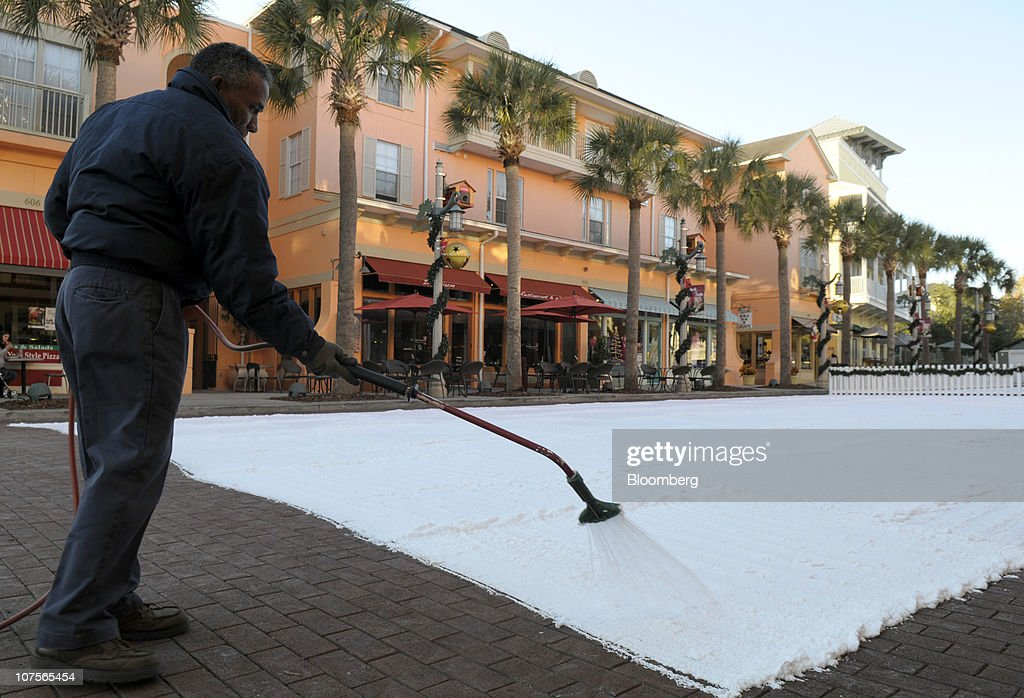 Jorge Rodriguez sprays 'snow' foam on a blocked off portion of a downtown street for the nightly holiday festivities in Celebration Florida US on...