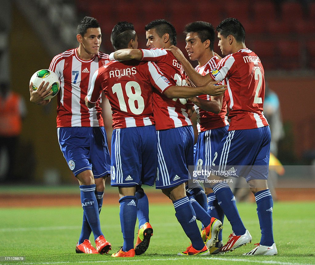 Jorge Rojas of Paraguay (2ndL) celebrates scoring a goal with his team mates during the FIFA U20 World Cup Group D match between Paraguay and Mali at Kamil Ocak Stadium on June 22, 2013 in Gaziantep, Turkey.