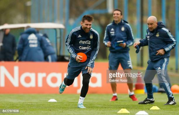 Jorge Sampaoli coach of Argentina gives directions to Lionel Messi during a training session at 'Julio Humberto Grondona' training camp on September...
