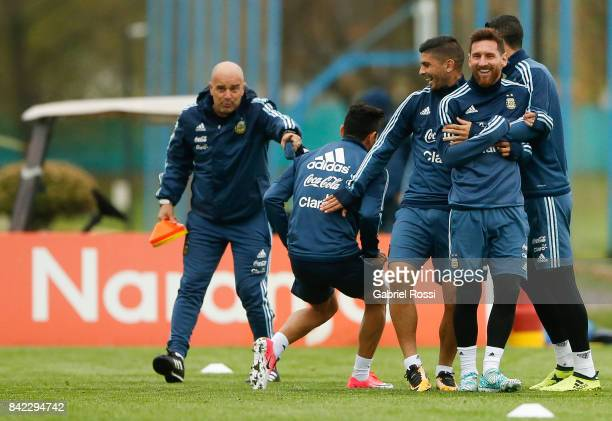 Jorge Sampaoli coach of Argentina gives directions to Lionel Messi Ever Banega and Angel Di Maria during a training session at 'Julio Humberto...