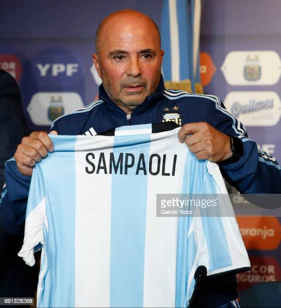 Jorge Sampaoli coach of Argentina poses with his jersey during his presentation as new Argentina coach at Argentine Football Association 'Julio...