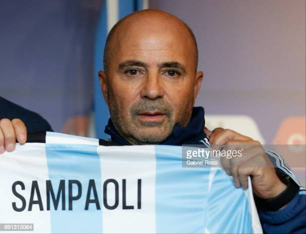 Jorge Sampaoli coach of Argentina shows his jersey during his presentation as new Argentina coach at Argentine Football Association 'Julio Humberto...