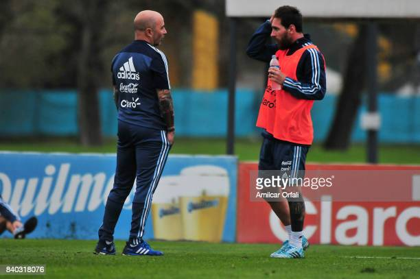 Jorge Sampaoli coach of Argentina talks to his player Lionel Messi during a training session at 'Julio Humberto Grondona' training camp on August 28...