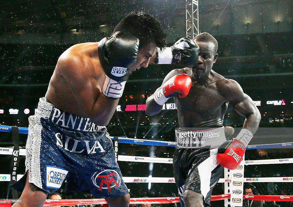 Jorge Silva of Mexico and Joshua Clottey of Ghana box during their super welterweight bout at Minute Maid Park on May 9 2015 in Houston Texas