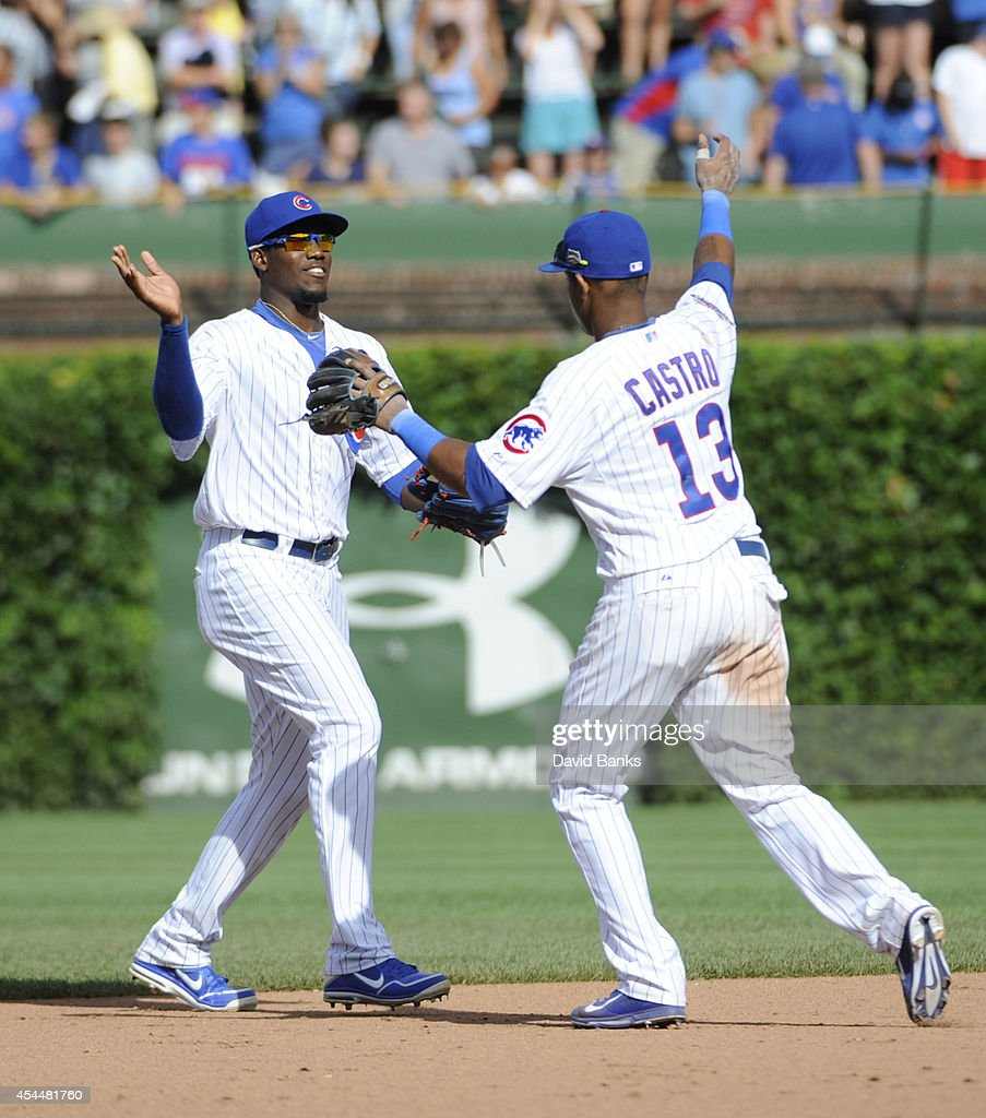 Jorge Soler #68 of the Chicago Cubs and Starlin Castro #13 of the Chicago Cubs celebrate the Cubs win on September 1, 2014 at Wrigley Field in Chicago, Illinois. The Chicago Cubs defeated the Milwaukee Brewers 4-2.