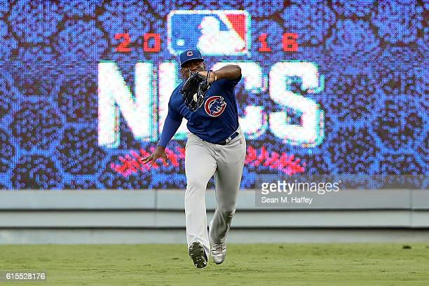 Jorge Soler of the Chicago Cubs catches a ball hit by Adrian Gonzalez of the Los Angeles Dodgers in the first inning in game three of the National...