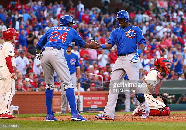 Jorge Soler of the Chicago Cubs celebrates with Dexter Fowler of the Chicago Cubs after hitting a tworun home run in the second inning against the St...