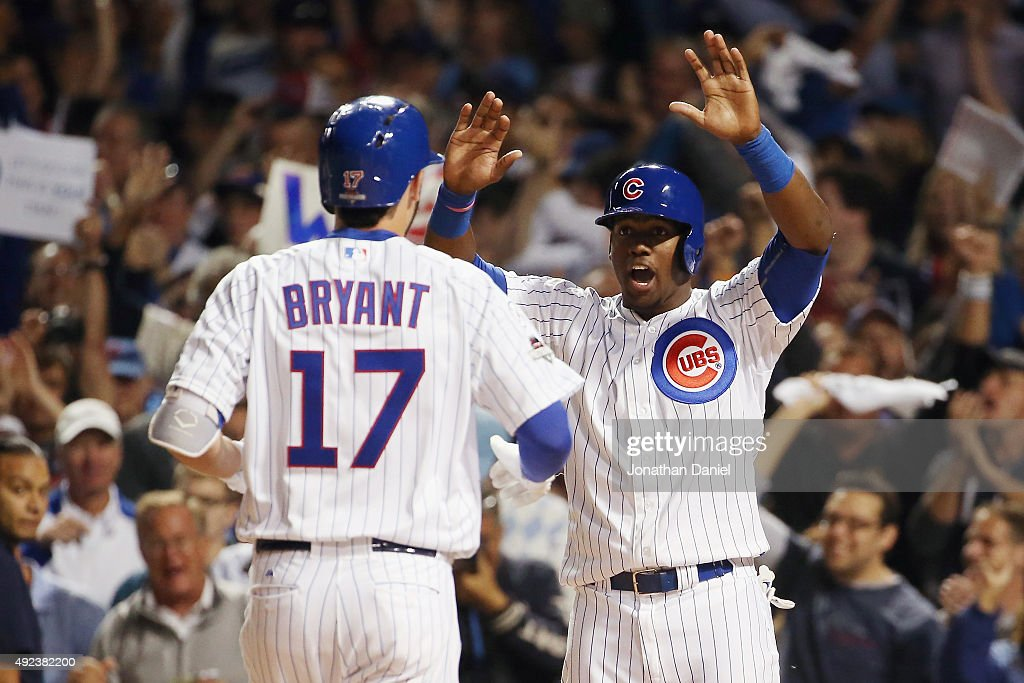 Jorge Soler of the Chicago Cubs greets Kris Bryant of the Chicago Cubs at home plate after Bryant hits a tworun home run in the fifth inning against...