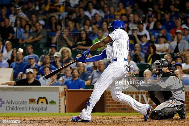 Jorge Soler of the Chicago Cubs hits a home run against the Pittsburgh Pirates during the ninth inning to tie the game at Wrigley Field on August 29...