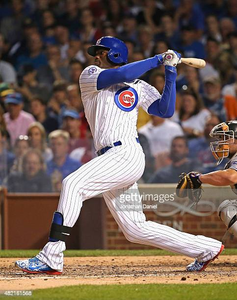 Jorge Soler of the Chicago Cubs hits a runscoring signle in the 4th inning against the Colorado Rockies at Wrigley Field on July 27 2015 in Chicago...
