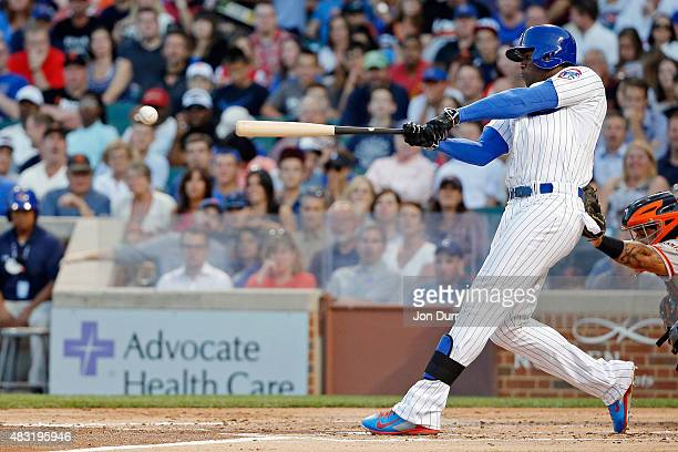 Jorge Soler of the Chicago Cubs hits a two run RBI single against the San Francisco Giants during the first inning at Wrigley Field on August 6 2015...