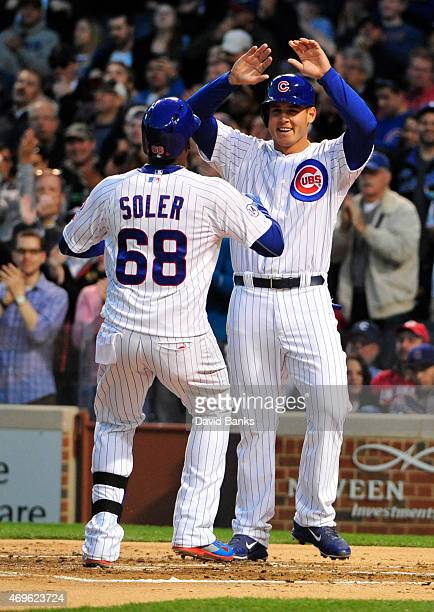 Jorge Soler of the Chicago Cubs is greeted by Anthony Rizzo after hitting a tworun homer against the Cincinnati Reds during the first inning on April...