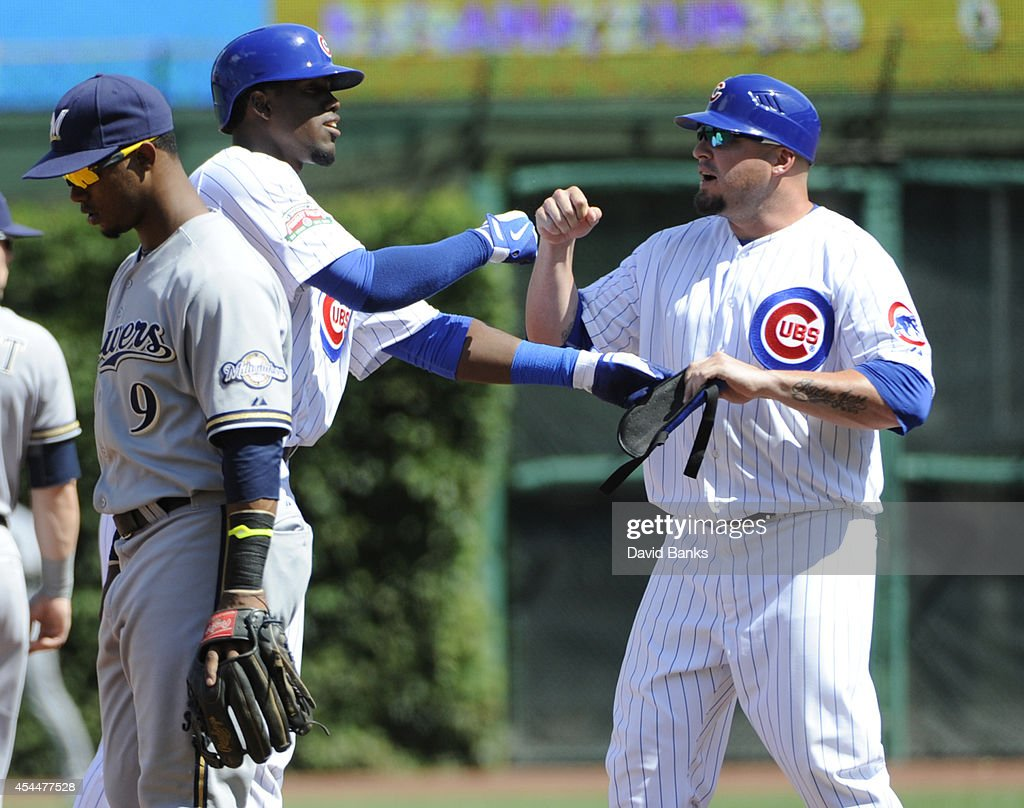 <a gi-track='captionPersonalityLinkClicked' href=/galleries/search?phrase=Jorge+Soler&family=editorial&specificpeople=10527376 ng-click='$event.stopPropagation()'>Jorge Soler</a> (C) of the Chicago Cubs is greeted by <a gi-track='captionPersonalityLinkClicked' href=/galleries/search?phrase=Eric+Hinske&family=editorial&specificpeople=213156 ng-click='$event.stopPropagation()'>Eric Hinske</a> #77 after hitting a double against the Milwaukee Brewers during the second inning on September 1, 2014 at Wrigley Field in Chicago, Illinois.
