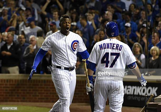 Jorge Soler of the Chicago Cubs is greeted by Miguel Montero after hitting a tworun homer against the Milwaukee Brewers during the second inning on...