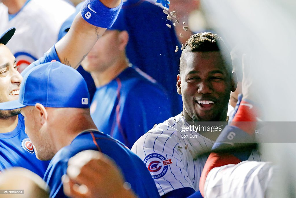 Jorge Soler of the Chicago Cubs is showered with sunflower seeds by Hector Rondon after hitting a home run against the Pittsburgh Pirates during the...
