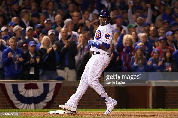 Jorge Soler of the Chicago Cubs reaches third base for a triple in the seventh inning against the Cleveland Indians in Game Three of the 2016 World...