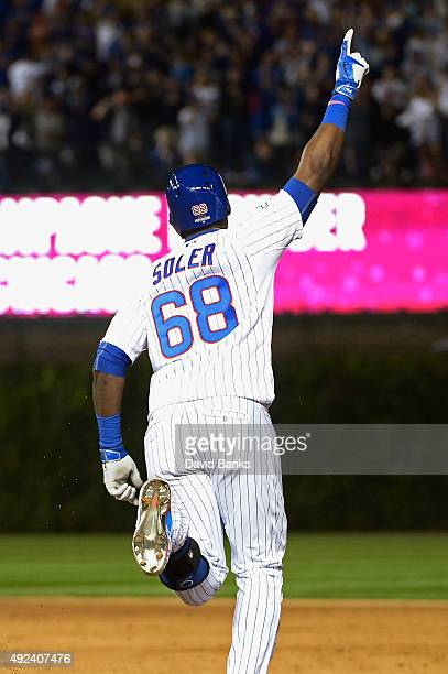 Jorge Soler of the Chicago Cubs runs the bases after hitting a tworun home run in the sixth inning against the St Louis Cardinals during game three...