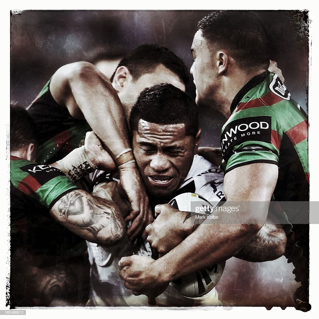 Jorge Taufua of the Eagles is tackled during the NRL Preliminary Final match between the South Sydney Rabbitohs and the Manly Warringah Sea Eagles at ANZ Stadium on September 27, 2013 in Sydney, Australia.