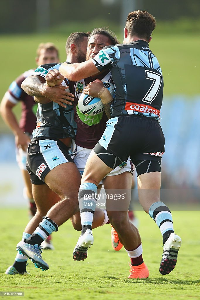 Jorge Taufua of the Eagles is tackled during the NRL Trial match between the Cronulla Sharks and the Manly Sea Eagles at Remondis Stadium on February 14, 2016 in Sydney, Australia.